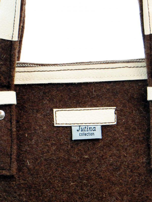 Pormenor da frente da carteira burel castanho com pele branca da Jutina