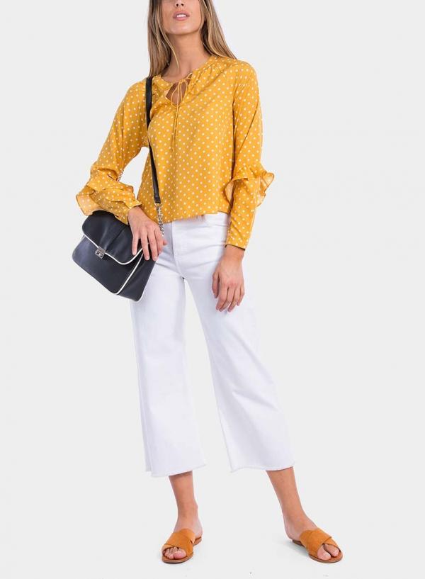 Frente de blusa às bolinhas com folhos em amarelo da Tiffosi